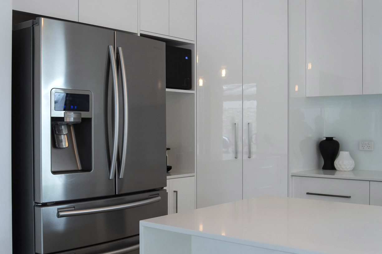 modern kitchen with steel fridge
