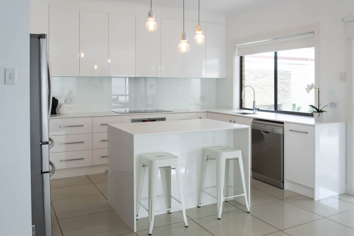 white kitchen with marble benchtop