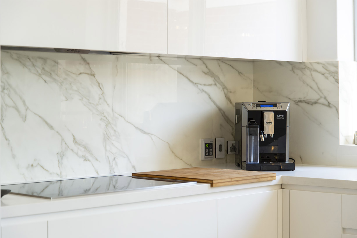 coffee maker infront of marble splashback
