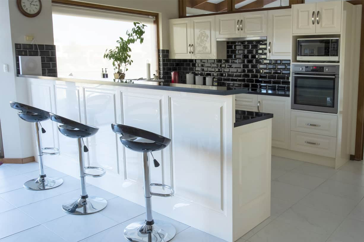 black bar stools behind kitchen counter